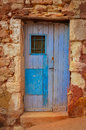 Old textured door in a stone wall Royalty Free Stock Images