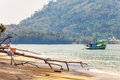 Old thai boat near the beach fishing on mountains background thailand Stock Photo