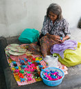 Old thai woman selling toys handmade on silom road bangkok thailand Royalty Free Stock Images