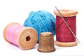 Old thimble and needle with thread Royalty Free Stock Photo