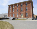Old three story red brick building Royalty Free Stock Photo