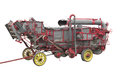 Old threshing machine isolated. Royalty Free Stock Photo