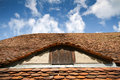 Old tiled roof with window Stock Images