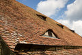 Old tiled roof with window Royalty Free Stock Photo