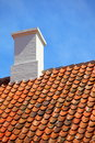 Old tiles red roof with himney sky background the roofing clay house chimney Royalty Free Stock Photo