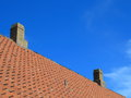 Old tiles red roof with himney sky background the roofing clay house chimney Royalty Free Stock Photography