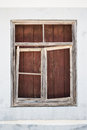 Old timber window frame boarded up a with a broken Royalty Free Stock Photography