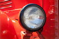 Old time car headlight. Retro style. Red. Classic. Royalty Free Stock Photo