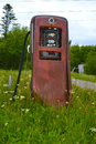Old time gas pump an by the roadside Royalty Free Stock Images