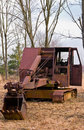 Old time heavy equipment mining shovel left to rust under winter conditions empty field Stock Image