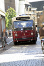 Old timer bus driving through Dordrecht Stock Photography