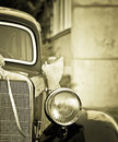Old timer with wedding decoration antique car in sepia vignette effect Stock Photography