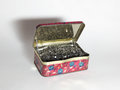 An old tin box full of Shoe nails Royalty Free Stock Photo