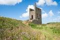 Old tin mine abandoned on the cornish coast england Stock Photos