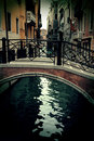 Old tiny bridge in venice, italy Royalty Free Stock Images