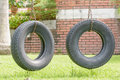 Old tires modify the swing in garden Stock Image