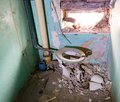 Old toilet an dilapidated with waste pipe and masonry Stock Image