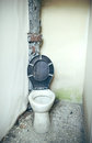 Old toilet an with lid open Royalty Free Stock Image