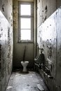 Old toilet an single with urinal Royalty Free Stock Photos