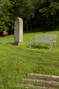 Old Tombstone & Bench Stock Image