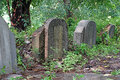 Old tombstones and graveyards in abandoned chinese cemetery Royalty Free Stock Photography