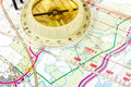 Old touristic compass on map Stock Photography