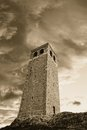 Old tower under cloudy sky in the evening Stock Photo