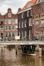 Old town in amsterdam traditional historic houses and bridge over canal the of north holland the netherlands Royalty Free Stock Photos
