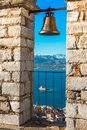 Old town of Nafplion in Greece view from bell tower, with tiled roofs, small port and bourtzi castle on the Mediterranean sea. Royalty Free Stock Photo