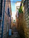stock image of  Old town narrow street with stairs, doors, windows and flower garlands Croatia