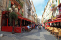 Old town of nice france may narrow pedestrian street in with sidewalk cafes souvenir shops and tourists walking around Royalty Free Stock Image