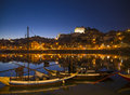 Old town river area of porto in portugal at night with rabelo boats Stock Photo