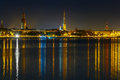 Old town and river daugava at night riga latvia of latvian academy of sciences cathedral saint peter church in the background Royalty Free Stock Image
