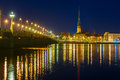 Old town and river daugava at night riga latvia saint peter church stone bridge in the of Stock Photography