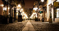 Old town street lights an city center pedestrian with causeway lighting poles and restaurants in buildings with food menu by the Stock Image