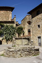 Old town in volpaia tuscany italy houses and a well at the medieval the chianti region Stock Photography