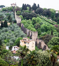 Old town walls of florence ancient stone ascending a hill around italy Stock Photography