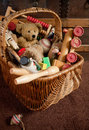 Old toys in a basket Royalty Free Stock Photo