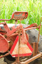 Old tractor and corn in front of field soon to be a halloween maze Royalty Free Stock Photos