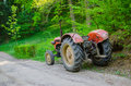 Old tractor on country road Royalty Free Stock Photo