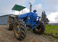 Old tractor at a dairy farm in sabah malaysia Royalty Free Stock Images