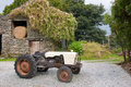 Old tractor in farmyard Royalty Free Stock Images