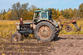 Old tractor field sunny day Royalty Free Stock Photo