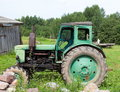 Old tractor in latvian farm soviet manufactured trасtor t am the village Stock Image