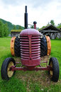 Old tractor in norway landscape freeland museum Stock Image