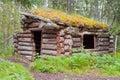 Old traditional log cabin rotting in Yukon taiga Royalty Free Stock Photo