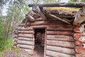Old traditional log cabin rotting in Yukon taiga Royalty Free Stock Photography