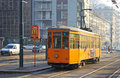 Old traditional peter witt tram on the street of milan italy december orange streetcar tramway network operation since Stock Photos