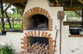 Old traditional ukrainian brick oven stove with open fire Royalty Free Stock Photo