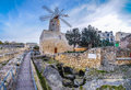 Old traditional windmill in Malta. Now an important tourist attr Royalty Free Stock Photo